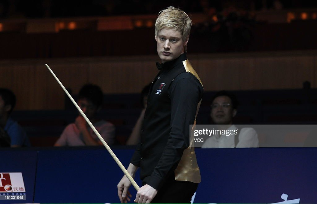 <a gi-track='captionPersonalityLinkClicked' href=/galleries/search?phrase=Neil+Robertson&family=editorial&specificpeople=668815 ng-click='$event.stopPropagation()'>Neil Robertson</a> of Australia looks on in the match against Mark King of England on day four of the 2013 World Snooker Shanghai Master at Shanghai Grand Stage on September 19, 2013 in Shanghai, China.