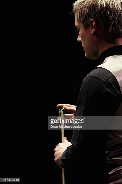 Neil Robertson of Australia looks to play his next shot during his Semi Final match with Judd Trump of England during day 7 of The Masters at...