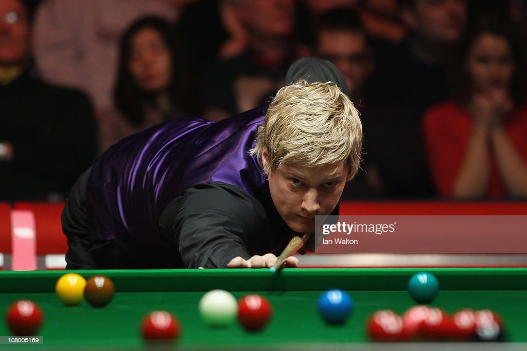 Neil Robertson of Australia plays a shot against Stephen Hendry of Scotland in Round One of The Ladbrokesmobile Masters on Day 4 at Wembley Arena on January 12, 2011 in London, England.