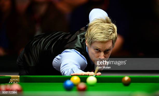 Neil Robertson of Australia plays a shot during his quarter final match against Judd Trump of England during Day Six of The Dafabet Masters at...