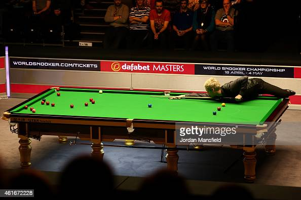 Neil Robertson of Australia plays a shot during his semifinal match against Ronnie O'Sullivan of Great Britain on day seven of the 2015 Dafabet...