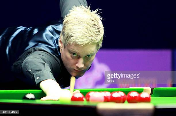 Neil Robertson of Australia plays a shot in the semifinal match against Barry Hawkins of England on day six of the 2014 World Snooker Wuxi Classic at...
