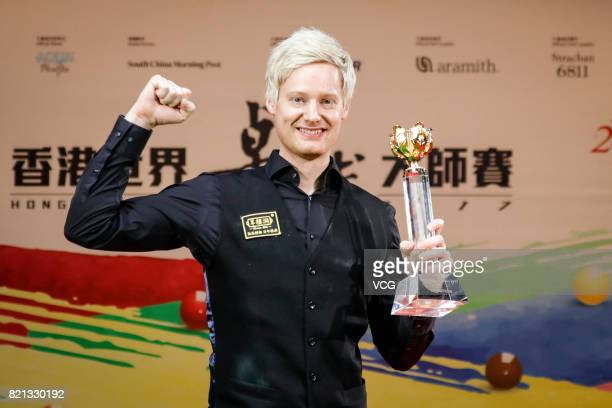 Neil Robertson of Australia poses with his trophy after winning the final match against Ronnie O'Sullivan of England on day four of 2017 Hong Kong...