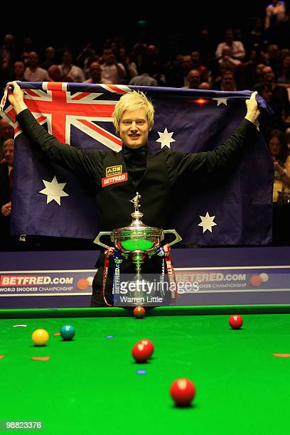 Neil Robertson of Australia poses with the trophy after beating Graeme Dott of Scotland during the final of the Betfredcom World Snooker...