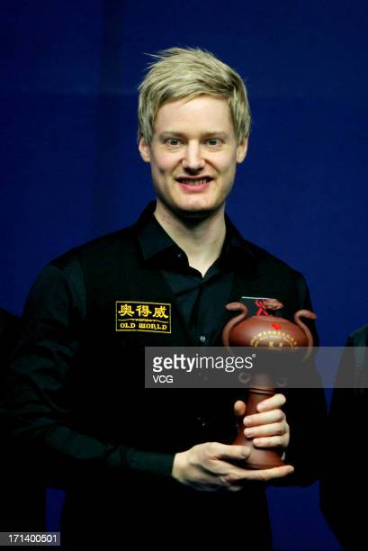 Neil Robertson of Australia poses with the trophy after defeating John Higgins of Scotland in the final match of Wuxi Snooker Classic at Wuxi City...