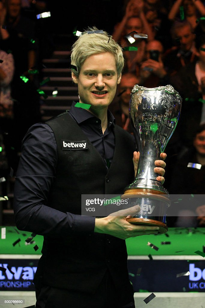 Neil Robertson of Australia poses with the trophy after the final match against Liang Wenbo of China on day 12 of Betway UK Championship at Barbican Centre on December 6, 2015 in York, England.