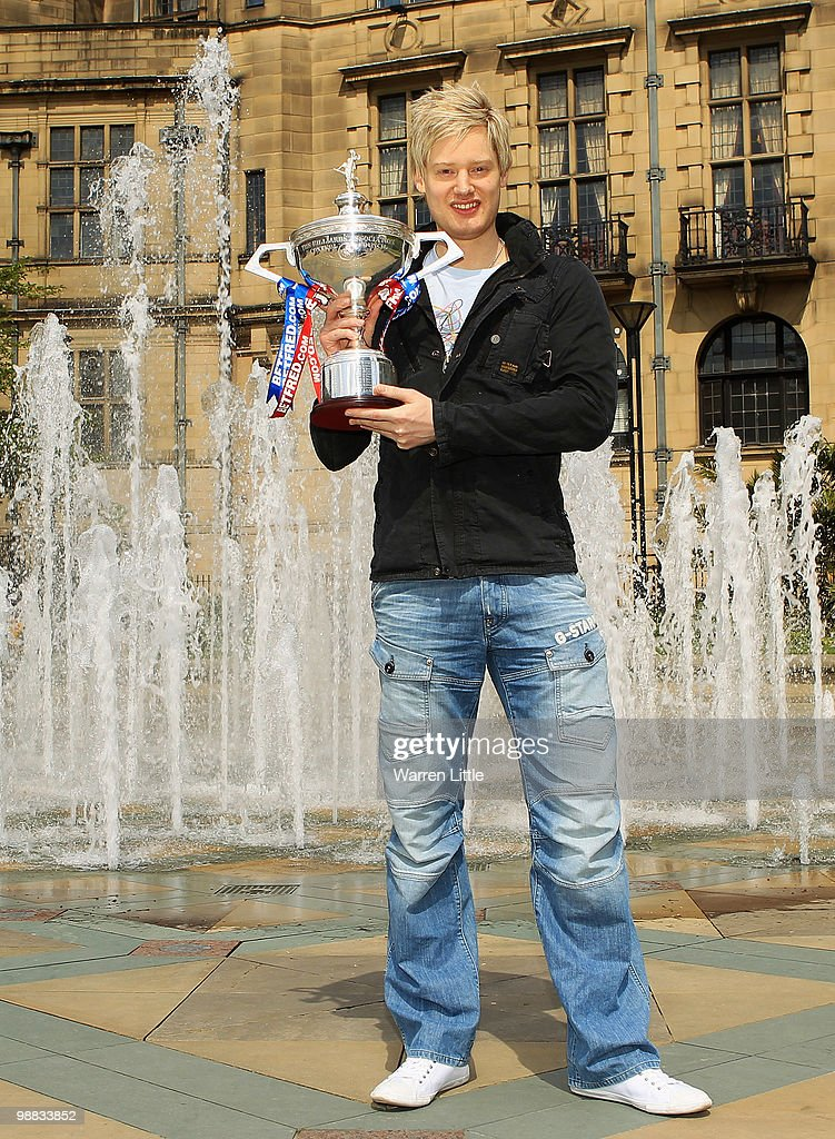 Neil Robertson of Australia poses with the trophy at a photocall after beating Graeme Dott of Scotland to win the Betfred.com World Snooker Championships at The Crucible Theatre on May 4, 2010 in Sheffield, England.