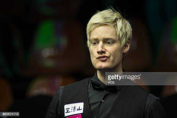 Neil Robertson of Australia reacts during his eighthfinal match against Mark Allen of Northern Ireland on day four of the World Open 2017 at Yushan...