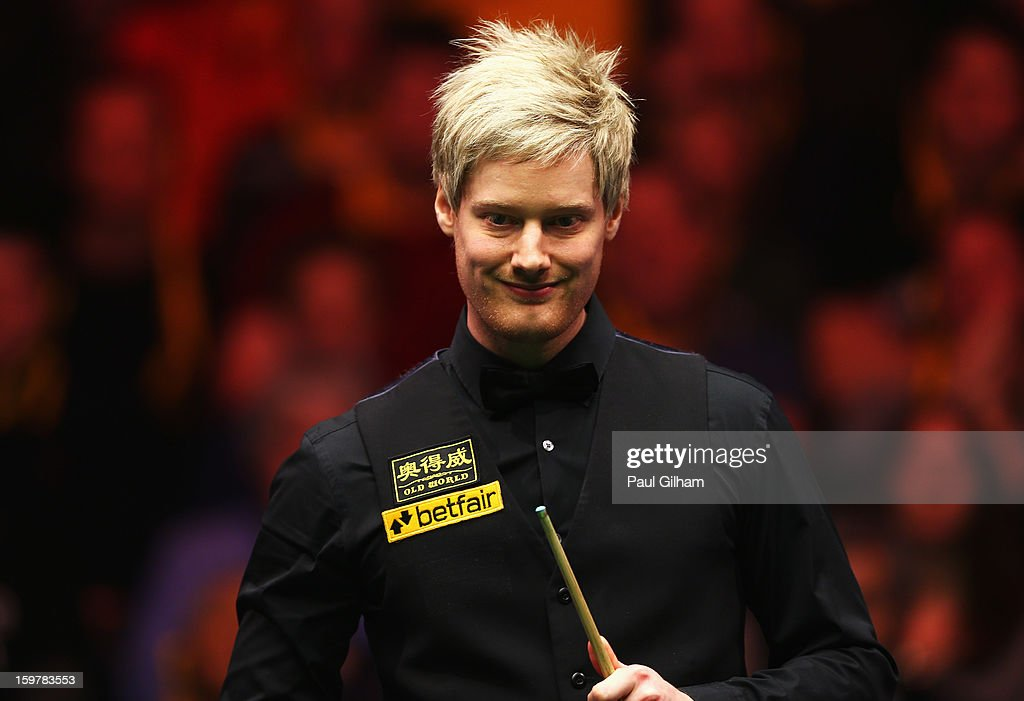 Neil Robertson of Australia reacts to a shot during The Masters Final between Mark Selby of England and Neil Robertson of Australia at Alexandra Palace on January 20, 2013 in London, England.