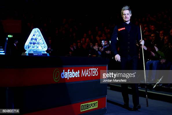 Neil Robertson of walks in ahead of his first round match against Marco Fu of Hong Kong during Day Four of the Dafabet Masters at Alexandra Palace on...