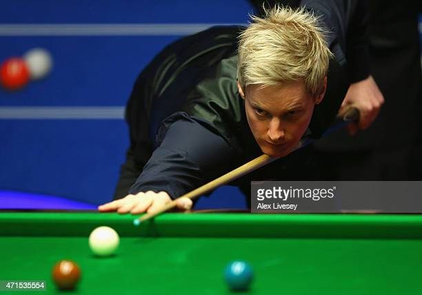 Neil Robertson plays a shot against Barry Hawkins during day twelve of the 2015 Betfred World Snooker Championship at Crucible Theatre on April 29...