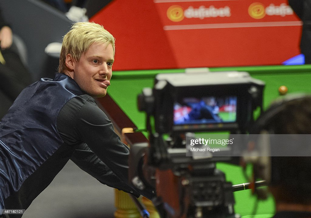 Neil Robertson plays a shot against Mark Allen during their second round match in The Dafabet World Snooker Championship at the Crucible Theatre on April 28, 2014 in Sheffield, England.