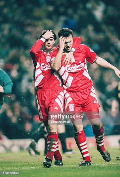 Neil Ruddock and Jamie Redknapp of Liverpool hold their heads in frustration as Manchester United score a late equalizer against Liverpool at Anfield...