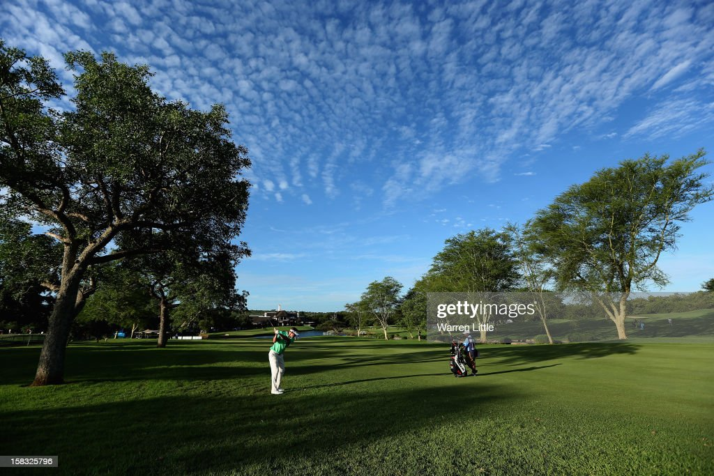 Neil Schietekat of South Africa plays his second shot on the 18th hole during the first round of the Alfred Dunhill Championship at Leopard Creek Country Golf Club on December 13, 2012 in Malelane, South Africa.