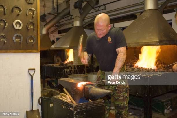 Neil Sherlock beats a white hot horse shoe into shape on an anvil A horse can get through a set of shoes in a month The blacksmiths need to shoe...