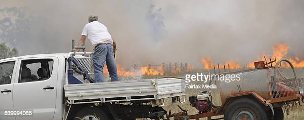 Neil Snape of Kamilaroi Road at Gunnedah protects his property from an approaching fire The blaze came within five metres of his woolshed where his...