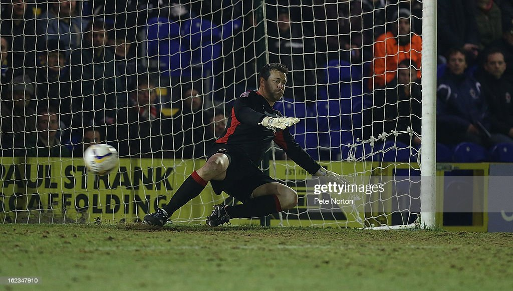 Neil Sulllivan of AFC Wimbledon is beaten by a penalty taken by Adebayo Akinfenwa for Northampton Town's equalizing goal during the npower League Two match between AFC Wimbledon and Northampton Town at The Cherry Red Records Stadium on February 19, 2013 in Kingston upon Thames, England.