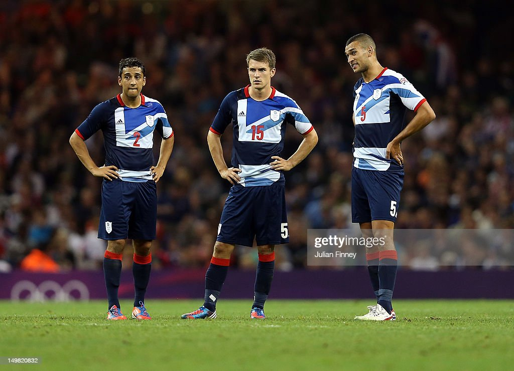 Neil Taylor of Great Britain, Aaron Ramsey of Great Britain and Steven Caulker of Great Britain look on during the Men's Football Quarter Final match between Great Britain and Korea, on Day 8 of the London 2012 Olympic Games at Millennium Stadium on August 4, 2012 in Cardiff, Wales.