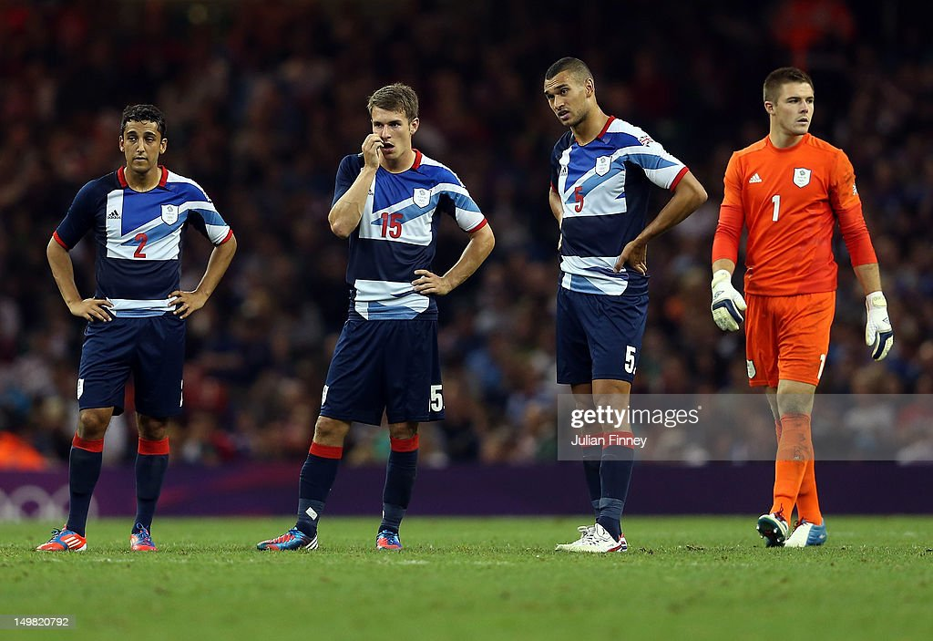 Neil Taylor of Great Britain, Aaron Ramsey of Great Britain, Steven Caulker of Great Britain and Jack Butland of Great Britain look on during the Men's Football Quarter Final match between Great Britain and Korea, on Day 8 of the London 2012 Olympic Games at Millennium Stadium on August 4, 2012 in Cardiff, Wales.