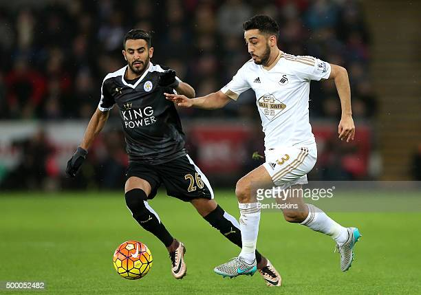 Neil Taylor of Swansea City and Riyad Mahrez of Leicester City compete for the ball during the Barclays Premier League match between Swansea City and...