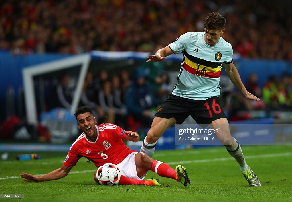 Neil Taylor of Wales and <a gi-track='captionPersonalityLinkClicked' href=/galleries/search?phrase=Thomas+Meunier&family=editorial&specificpeople=8330376 ng-click='$event.stopPropagation()'>Thomas Meunier</a> of Belgium compete for the ball during the UEFA EURO 2016 quarter final match between Wales and Belgium at Stade Pierre-Mauroy on July 1, 2016 in Lille, France.