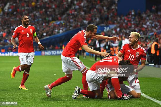 Neil Taylor of Wales celebrates scoring his team's second goal with his team mates during the UEFA EURO 2016 Group B match between Russia and Wales...