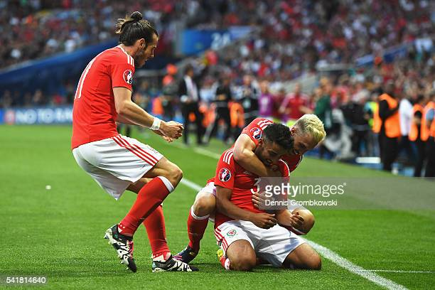 Neil Taylor of Wales celebrates scoring his team's second goal with his team mate Aaron Ramsey and Gareth Bale during the UEFA EURO 2016 Group B...