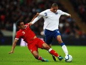 Neil Taylor of Wales challenges Chris Smalling of England during the UEFA EURO 2012 group G qualifying match between England and Wales at Wembley...