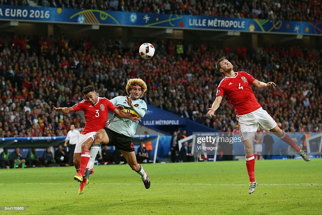 Neil Taylor of Wales, Marouane Fellaini of Belgium, Ben Davies of Wales during the UEFA EURO 2016 quarter final match between Wales and Belgium on July 2, 2016 at the Stade Pierre Mauroy in Lille, France.