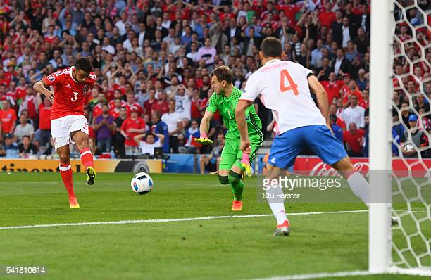 Neil Taylor of Wales scores his team's second goal past Igor Akinfeev of Russia during the UEFA EURO 2016 Group B match between Russia and Wales at...