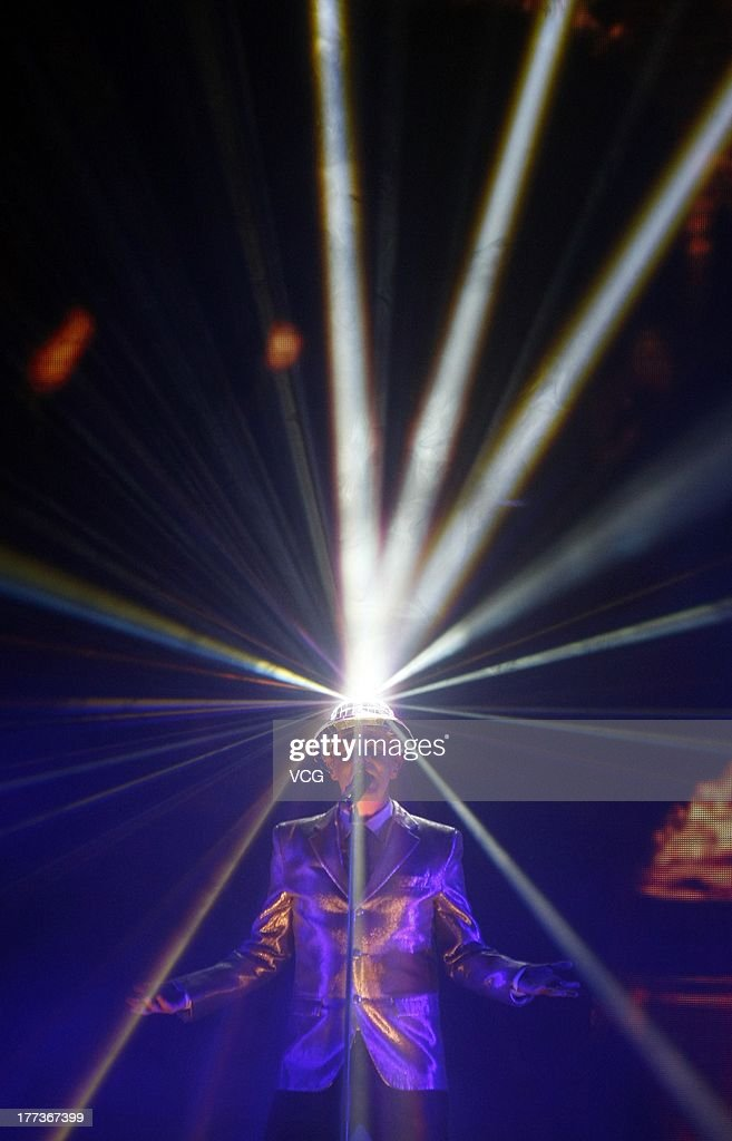 <a gi-track='captionPersonalityLinkClicked' href=/galleries/search?phrase=Neil+Tennant&family=editorial&specificpeople=213865 ng-click='$event.stopPropagation()'>Neil Tennant</a> of Pet Shop Boys performs on the stage in concert at MasterCard Center on August 22, 2013 in Beijing, China.