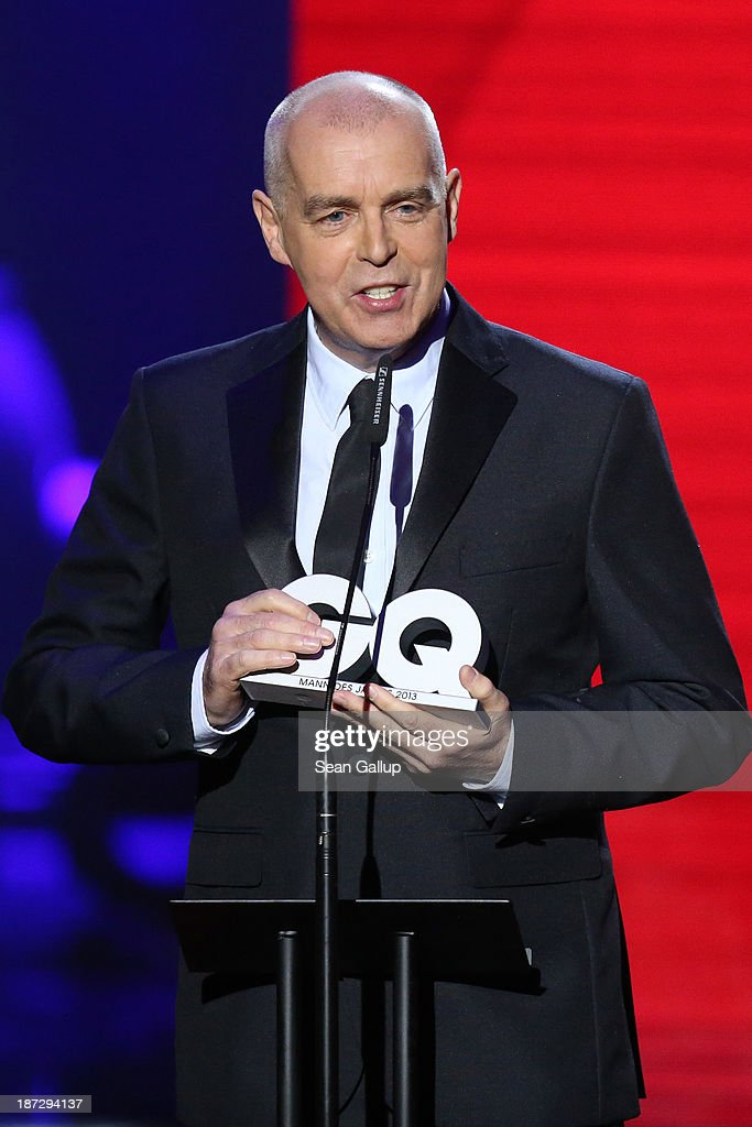 (TO BE USED EXCLUSIVELY FOR POST-EVENT REPORTING TO GQ MEN OF THE YEAR 2013, DO NOT USE AFTER) <a gi-track='captionPersonalityLinkClicked' href=/galleries/search?phrase=Neil+Tennant&family=editorial&specificpeople=213865 ng-click='$event.stopPropagation()'>Neil Tennant</a> singer of 'The Pet Shop Boys' receives an award on stage at the GQ Men Of The Year Award at Komische Oper on November 7, 2013 in Berlin, Germany.