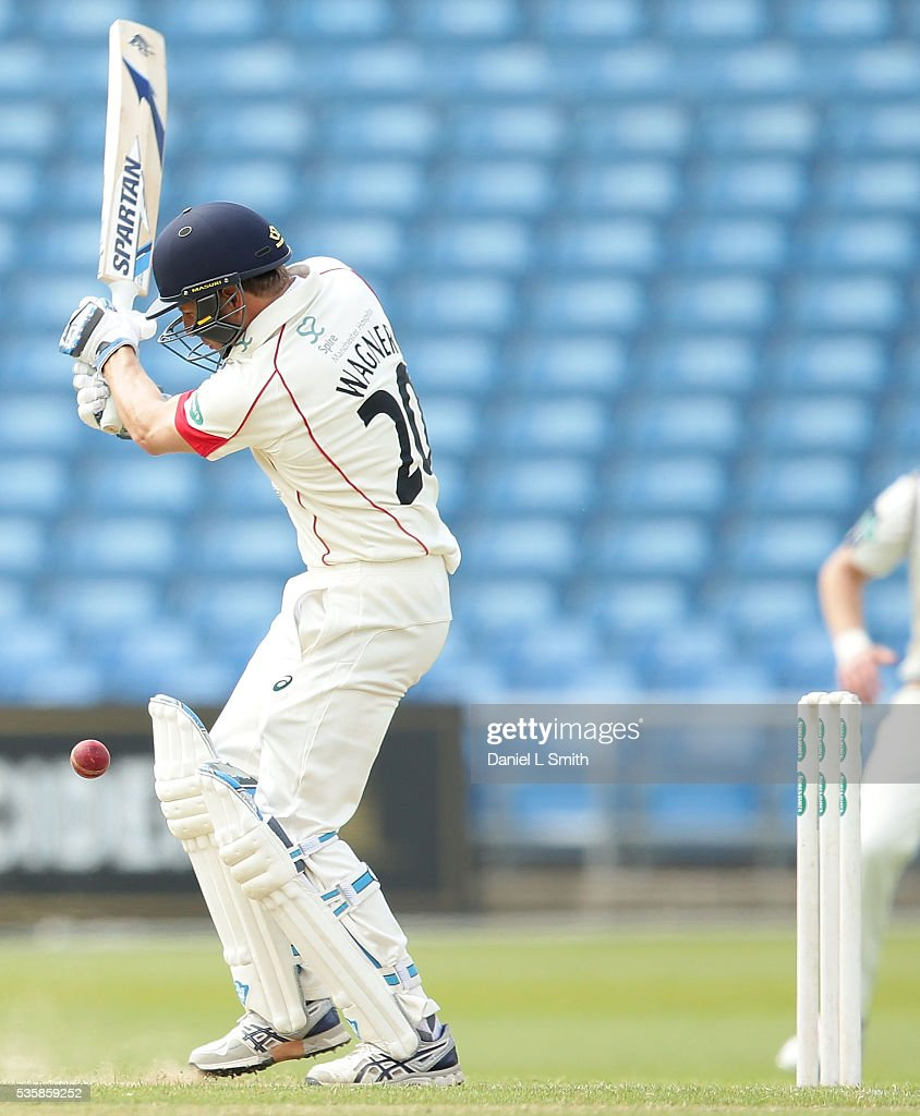 Neil Wagner of Lancashire is trapped LBW from a delivery by Adil Rashid of Yorkshire during day two of the Specsavers County Championship: Division One match between Yorkshire and Lancashire at Headingley on May 30, 2016 in Leeds, England.