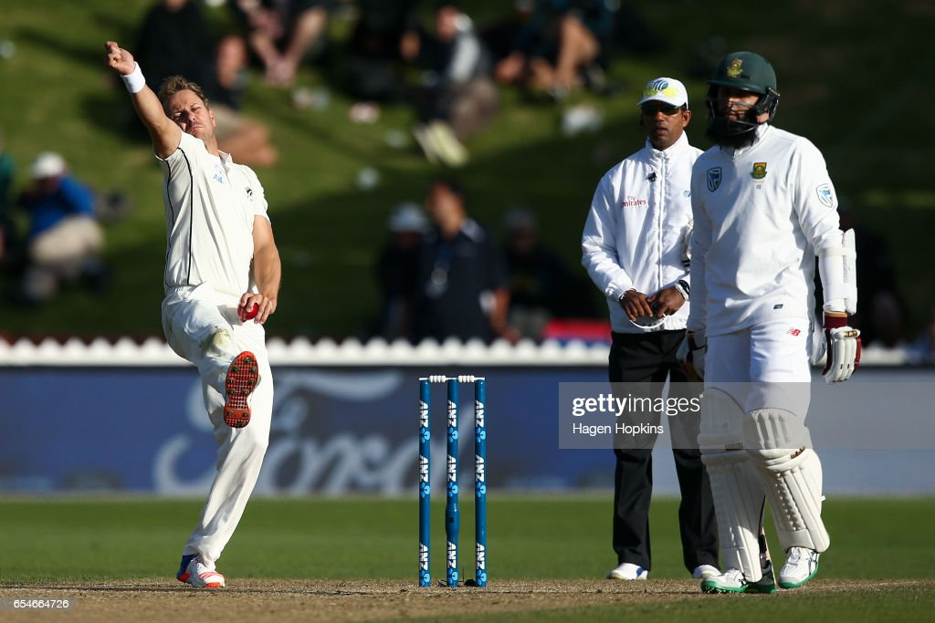 Neil Wagner of New Zealand bowls while Hashim Amla of South Africa looks on during day three of the test match between New Zealand and South Africa at Basin Reserve on March 18, 2017 in Wellington, New Zealand.