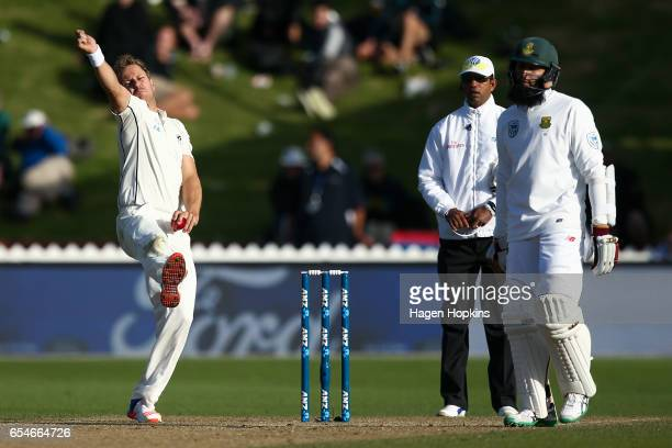 Neil Wagner of New Zealand bowls while Hashim Amla of South Africa looks on during day three of the test match between New Zealand and South Africa...