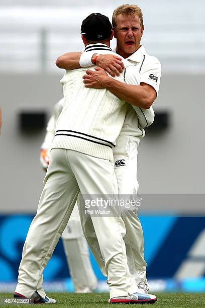 Neil Wagner of New Zealand celebrates bowling Murali Vijay of India with Brendon McCullum during day two of the First Test match between New Zealand...