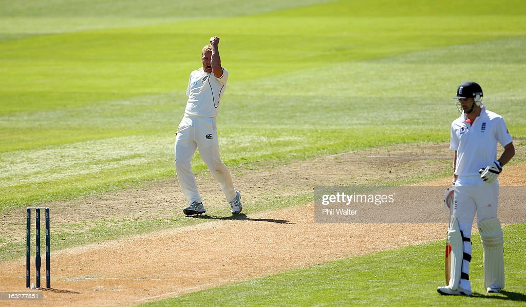 Neil Wagner of New Zealand (C) celebrates his dismissal of Steven Finn of England during day two of the First Test match between New Zealand and England at University Oval on March 7, 2013 in Dunedin, New Zealand.