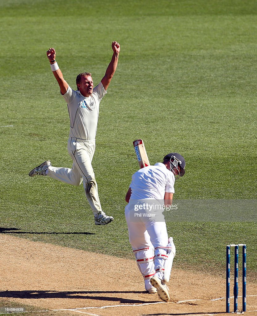 Neil Wagner of New Zealand celebrates his wicket of <a gi-track='captionPersonalityLinkClicked' href=/galleries/search?phrase=Jonathan+Trott&family=editorial&specificpeople=654505 ng-click='$event.stopPropagation()'>Jonathan Trott</a> of England (R) during day four of the Third Test match between New Zealand and England at Eden Park on March 25, 2013 in Auckland, New Zealand.