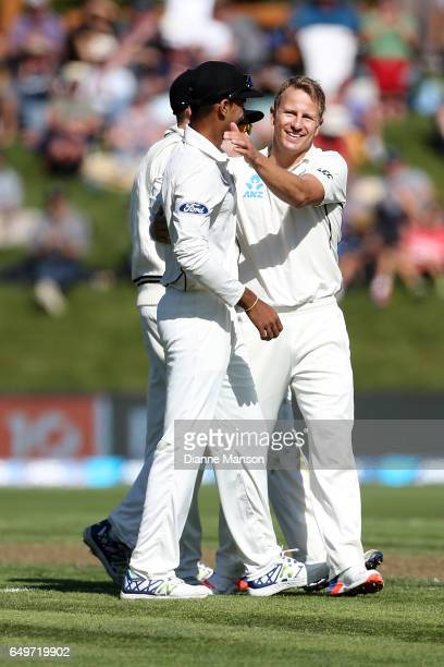 Neil Wagner of New Zealand celebrates the dismissal of Dean Elgar of South Africa during day two of the First Test match between New Zealand and...
