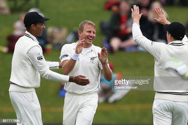 Neil Wagner of New Zealand celebrates the dismissal of Hashim Amla during day four of the First Test match between New Zealand and South Africa at...