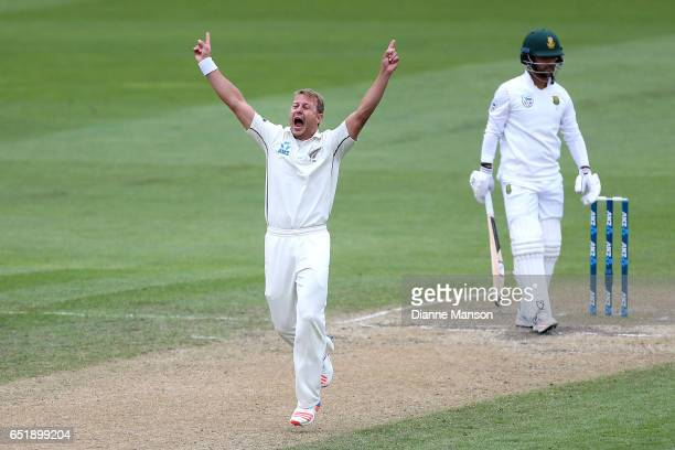 Neil Wagner of New Zealand celebrates the dismissal of JP Duminy of South Africa during day four of the First Test match between New Zealand and...