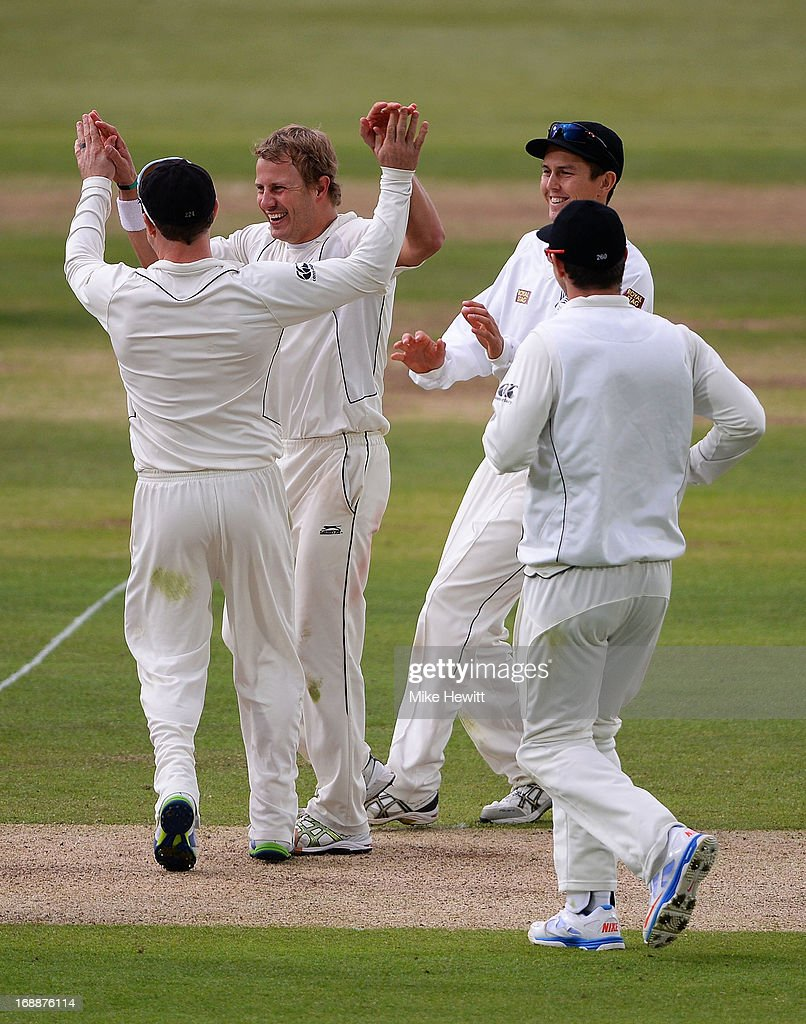 Neil Wagner of New Zealand (2nd R) celebrates with team mates after dismissing Ian Bell of England during day one of 1st Investec Test match between England and New Zealand at Lord's Cricket Ground on May 16, 2013 in London, England.