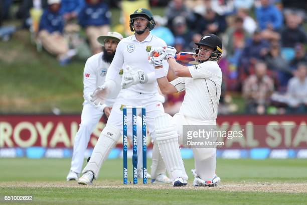 Neil Wagner of New Zealand hits a boundary during day three of the First Test match between New Zealand and South Africa at University Oval on March...