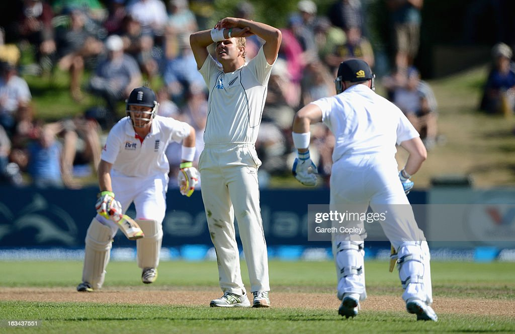 Neil Wagner of New Zealand reacts as Matt Prior and Ian Bell score runs during day five of the First Test match between New Zealand and England at University Oval on March 10, 2013 in Dunedin, New Zealand.