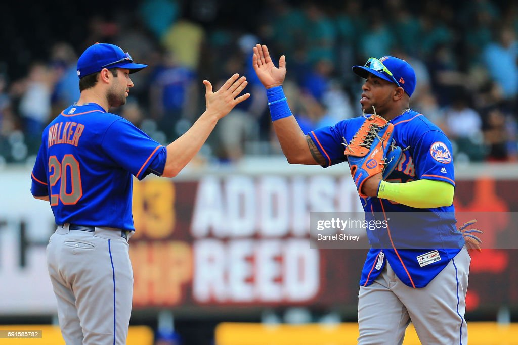 Neil Walker #20 and Yoenis Cespedes #52 of the New York Mets celebrate beating the Atlanta Braves at SunTrust Park on June 10, 2017 in Atlanta, Georgia.