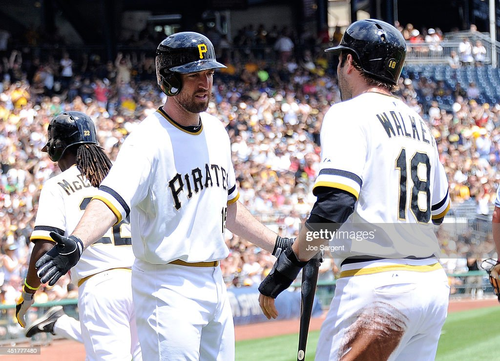 Neil Walker #18 celebrates with <a gi-track='captionPersonalityLinkClicked' href=/galleries/search?phrase=Ike+Davis&family=editorial&specificpeople=2349664 ng-click='$event.stopPropagation()'>Ike Davis</a> #15 of the Pittsburgh Pirates after scoring in the first inning against the Philadelphia Phillies on July 6, 2014 at PNC Park in Pittsburgh, Pennsylvania.