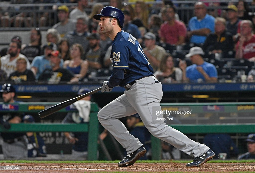 Neil Walker #15 of the Milwaukee Brewers hits an RBI single to center field in the sixth inning during the game against the Pittsburgh Pirates at PNC Park on September 18, 2017 in Pittsburgh, Pennsylvania.