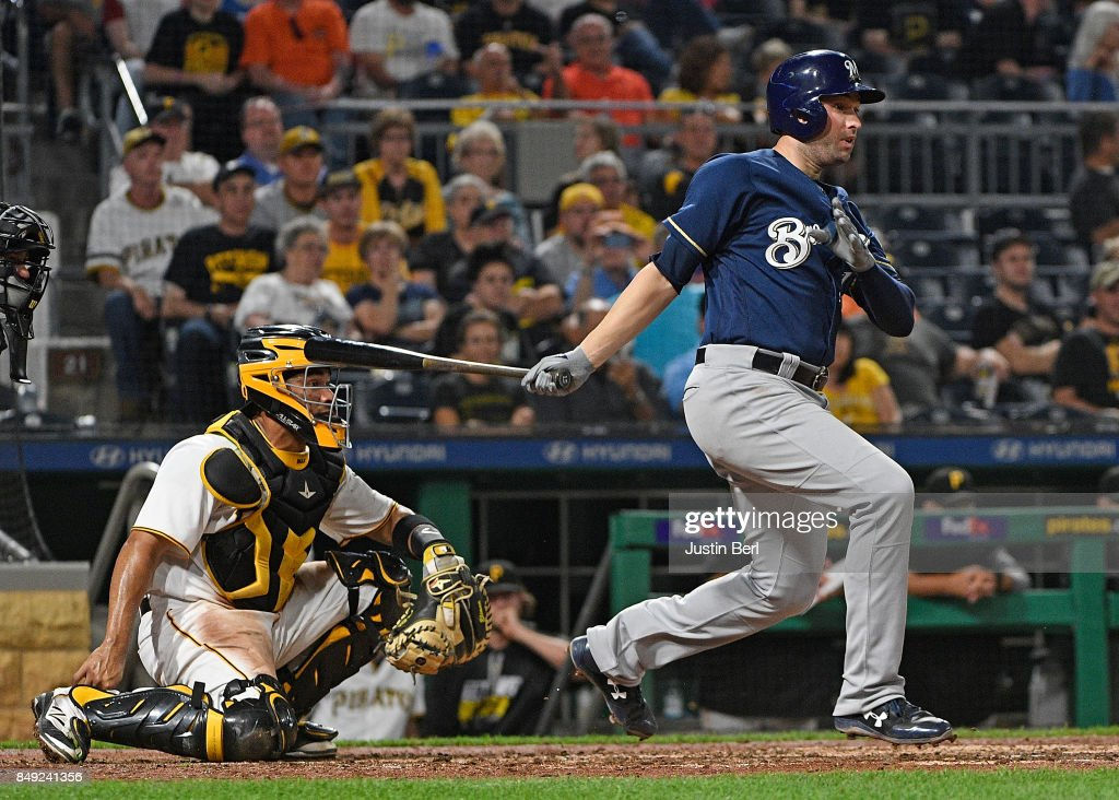 Neil Walker #15 of the Milwaukee Brewers singles to right field in the eighth inning during the game against the Pittsburgh Pirates at PNC Park on September 18, 2017 in Pittsburgh, Pennsylvania.