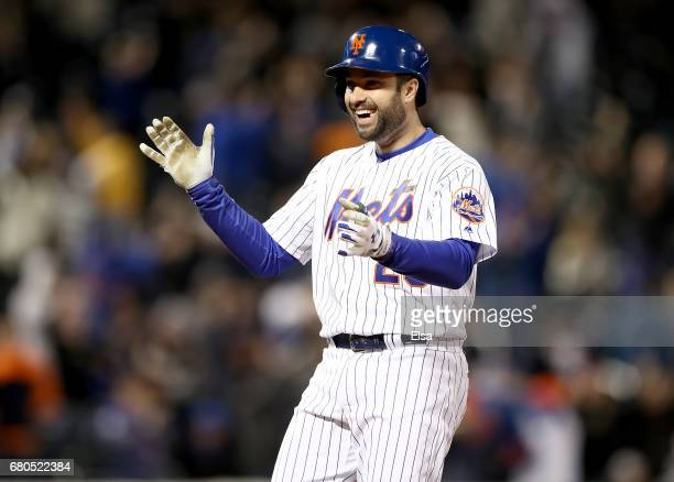 Neil Walker of the New York Mets celebrates after he drove in the game winning run in the ninth inning against the San Francisco Giants on May 8 2017...