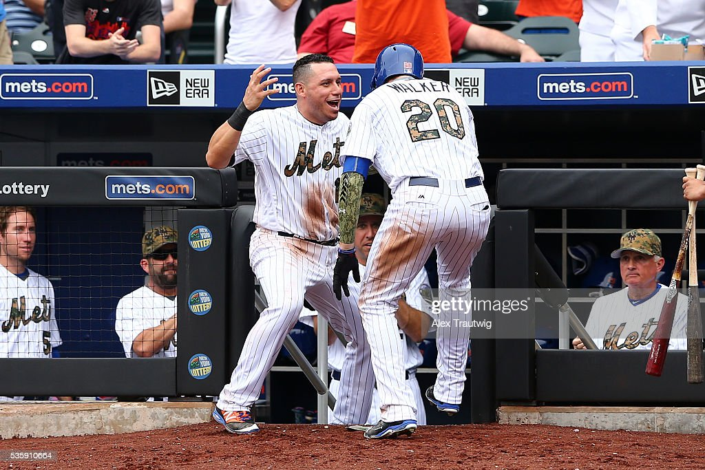 <a gi-track='captionPersonalityLinkClicked' href=/galleries/search?phrase=Neil+Walker+-+Baseball+Player&family=editorial&specificpeople=7841262 ng-click='$event.stopPropagation()'>Neil Walker</a> #20 of the New York Mets is met by <a gi-track='captionPersonalityLinkClicked' href=/galleries/search?phrase=Asdrubal+Cabrera&family=editorial&specificpeople=834042 ng-click='$event.stopPropagation()'>Asdrubal Cabrera</a> #13 at the dugout after hitting a solo home run in the seventh inning during the game against the Chicago White Sox at Citi Field on Monday, May 30, 2016 in the Queens borough of New York City.